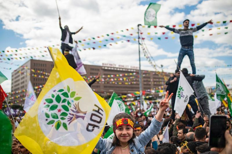 Supporters of Turkey's main pro-Kurdish People's Democratic Party (HDP) party cheer as they celebrate the Kurdish New Year during a campaign rally in Istanbul on March 24, 2019 ahead of the March 31 local elections