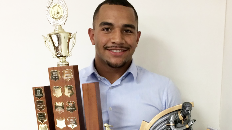 Ziggie Vincent, pictured here with a rugby league trophy.