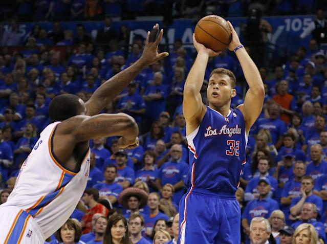 Los Angeles Clippers forward Blake Griffin,right, shoots over Oklahoma City Thunder center Kendrick Perkins, left, in the first quarter of Game 1 of the Western Conference semifinal NBA basketball playoff series in Oklahoma City, Monday, May 5, 2014. (AP Photo/Sue Ogrocki)