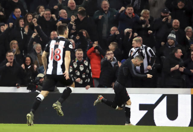 Newcastle United's Miguel Almiron, right, celebrates scoring his side's first goal of the game, during the English Premier League soccer match between Newcastle United and Crystal Palace, at St James' Park, in Newcastle, England, Saturday, Dec. 21, 2019. (Owen Humphreys/PA via AP)
