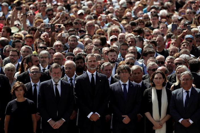 Spanish Prime Minister Mariano Rajoy (centre) leads a minute of silence at Placa de Catalunya REUTERS/Susana Vera