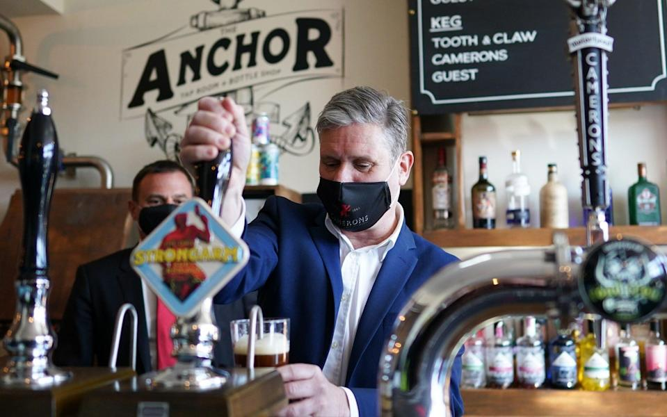 Sir Keir Starmer pulls a pint as he visits the Cameron brewery in Hartlepool - Getty