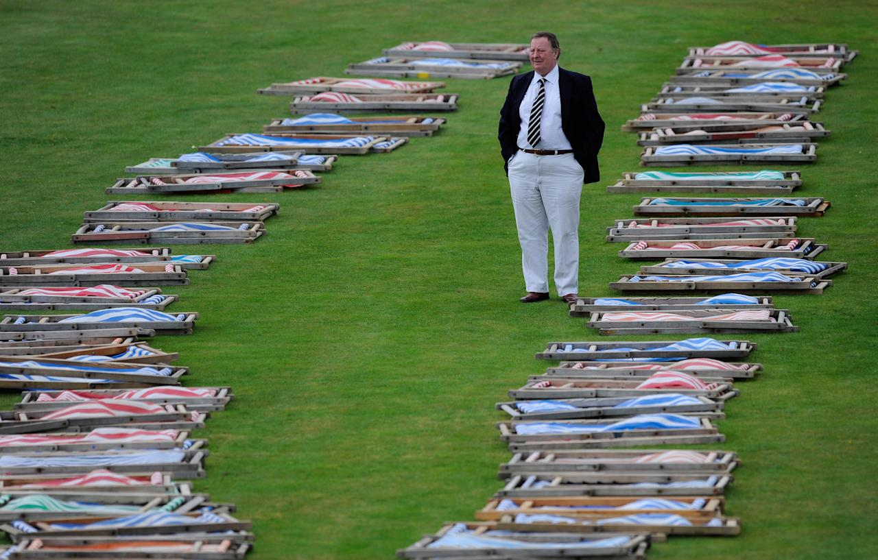 SCARBOROUGH, ENGLAND - AUGUST 26:  Yorkshire members stand amongst the rain soaked deckchairs as rain delays play during the LV County Championship Match between Yorkshire and Warwickshire at North Marine Road on August 26, 2009 in Scarborough, England.  (Photo by Laurence Griffiths/Getty Images)