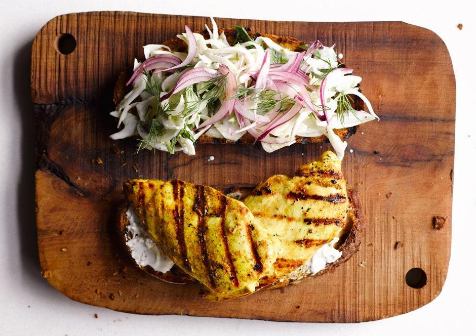 """Thanks to a flavorful brine and a supershort cook time, sandwich-friendly boneless breasts take on a whole new life between two slices of bread. <a href=""""https://www.bonappetit.com/recipe/curried-chicken-sandwich?mbid=synd_yahoo_rss"""" rel=""""nofollow noopener"""" target=""""_blank"""" data-ylk=""""slk:See recipe."""" class=""""link rapid-noclick-resp"""">See recipe.</a>"""