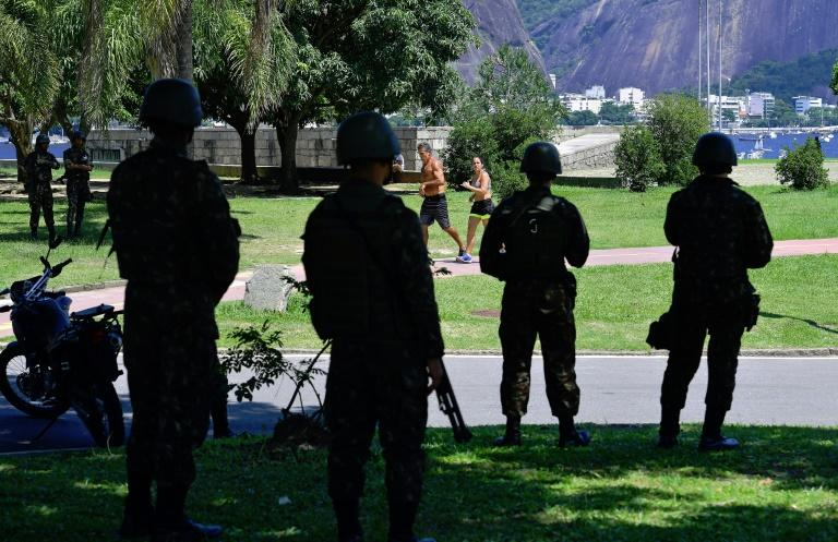 Soldiers stand guard along Flamengo beach, Rio de Janeiro, after President Michel Temer started implementing his decree giving the military full control over security in crime-plagued Rio