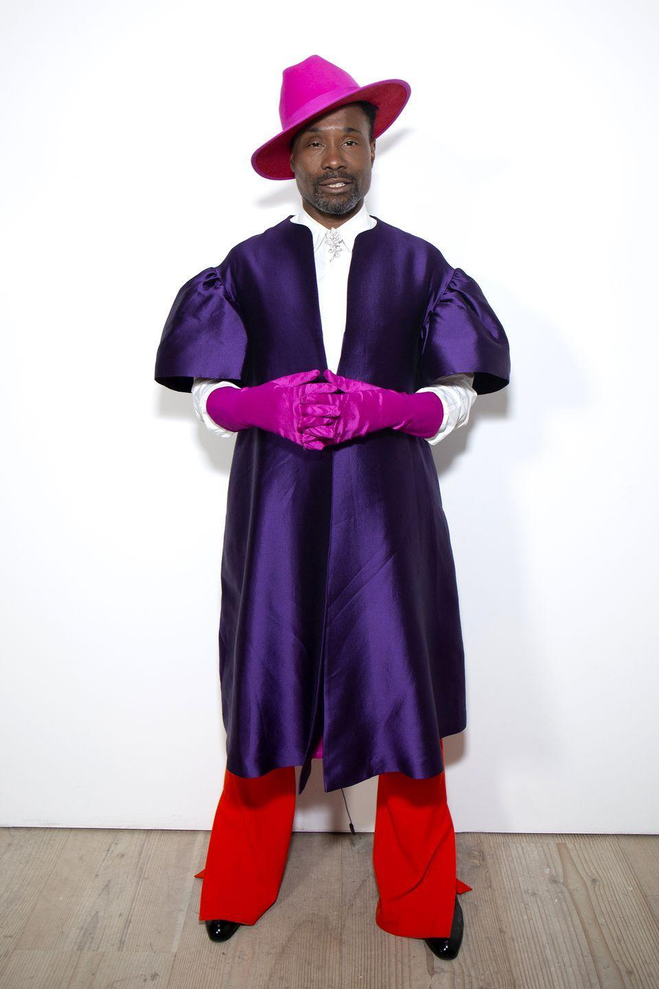 <p>Porter poses for the camera here following his 'Talk: Billy Porter in conversation with Lindsay People Wagner' during London Fashion Week.</p><p>For the event, the 50-year-old wore a fuchsia-coloured hat by Keith and James, matching coloured gloves by Wing Weft Gloves and red trouser by Victoria Beckham. </p>