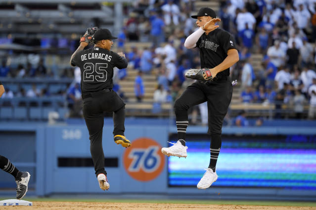 New York Yankees' Gleyber Torres, left, celebrates with Aaron Judge after the Yankees defeated the Los Angeles Dodgers 5-1 in a baseball game, Sunday, Aug. 25, 2019, in Los Angeles. (AP Photo/Mark J. Terrill)