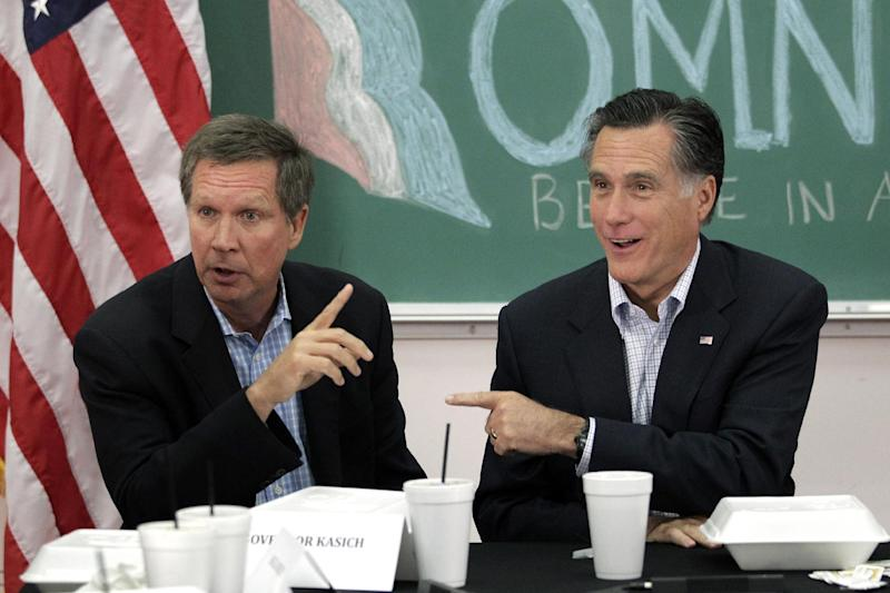 FILE - In this April 27, 2012 file photo, Republican presidential candidate, former Massachusetts Gov. Mitt Romney and Ohio Gov. John Kasich participant in a roundtable discussion in Westerville, Ohio. While Romney faults President Barack Obama for a weak American economy, Republican governors across the country are merrily trumpeting tales of business growth and falling employment. (AP Photo/Jae C. Hong, File)