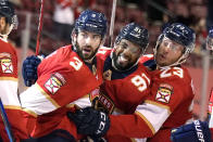Florida Panthers defenseman Keith Yandle (3) celebrates with left wing Anthony Duclair (91) and center Carter Verhaeghe (23) after scoring a goal during the second period of an NHL hockey game against the Dallas Stars, Monday, Feb. 22, 2021, in Sunrise, Fla. (AP Photo/Lynne Sladky)
