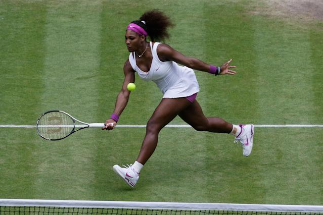 LONDON, ENGLAND - JULY 07: Serena Williams of the USA returns the ball during her Ladies? Singles final match against Agnieszka Radwanska of Poland on day twelve of the Wimbledon Lawn Tennis Championships at the All England Lawn Tennis and Croquet Club on July 7, 2012 in London, England. (Photo by Anja Niedringhaus/Pool/Getty Images)