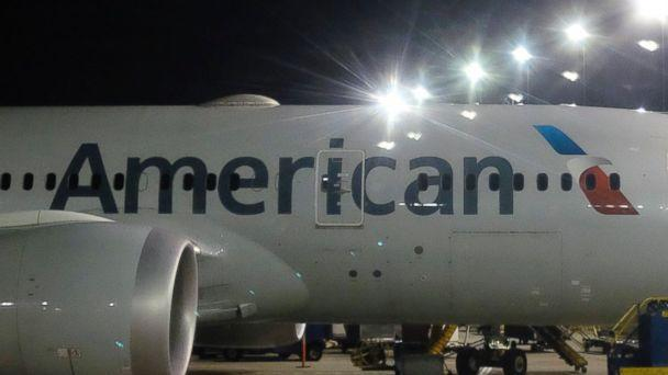 This Nov. 25, 2017 file photo shows an American Airlines plane parked at a gate. (AP)