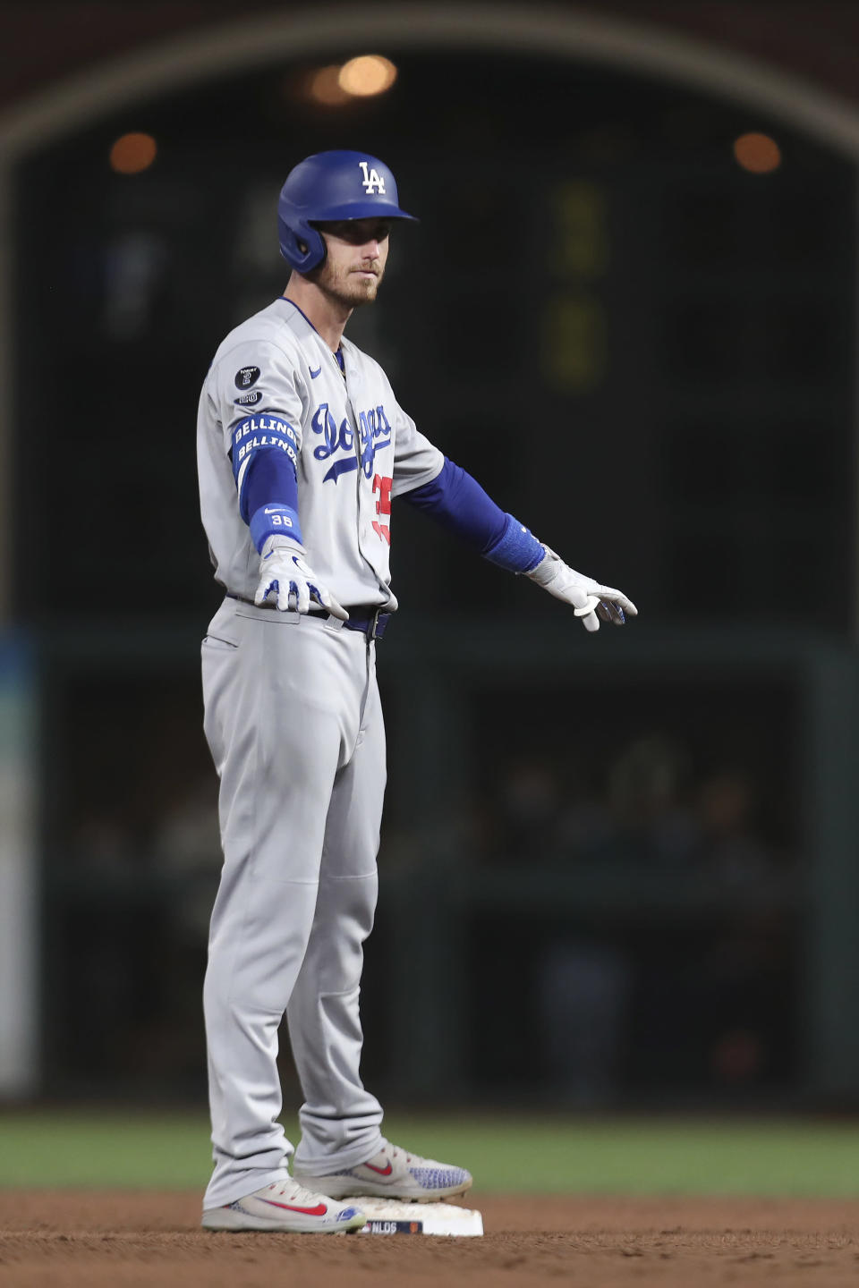 Los Angeles Dodgers' Cody Bellinger gestures after hitting a two-run double against the San Francisco Giants during the sixth inning of Game 2 of a baseball National League Division Series Saturday, Oct. 9, 2021, in San Francisco. (AP Photo/Jed Jacobsohn)