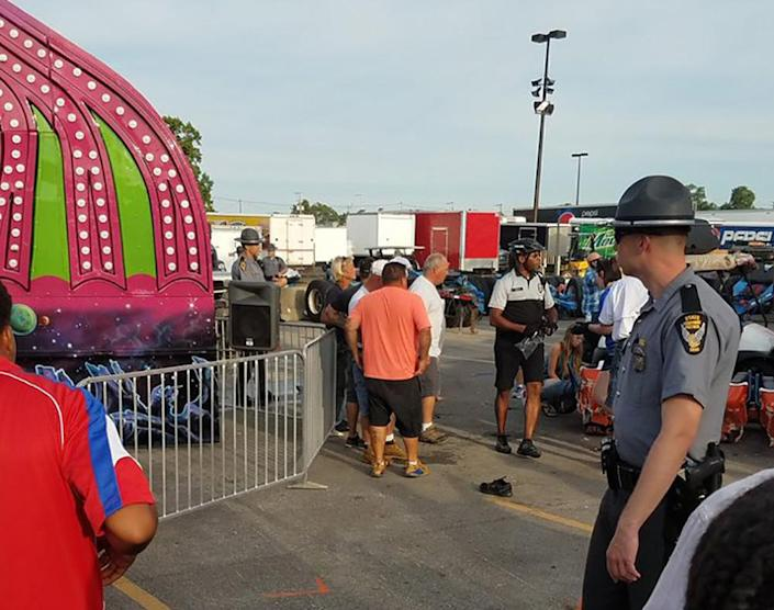 <p>Authorities respond near the Fire Ball amusement ride after the ride malfunctioned injuring several at the Ohio State Fair, Wednesday, July 26, 2017, in Columbus, Ohio. Some of the victims were thrown from the ride when it malfunctioned Wednesday night, said Columbus Fire Battalion Chief Steve Martin. (Justin Eckard via AP) </p>