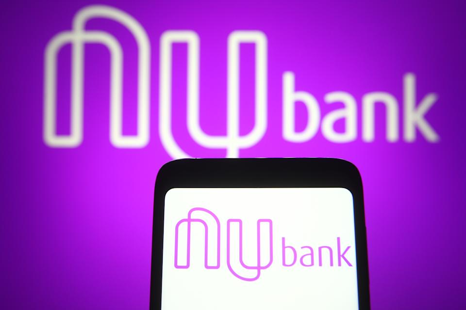 UKRAINE - 2021/04/26: In this photo illustration, the Nubank logo of a Brazilian digital bank is seen on a smartphone and a pc screen. (Photo Illustration by Pavlo Gonchar/SOPA Images/LightRocket via Getty Images)