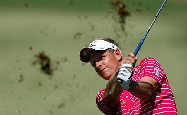 ATLANTA, GA - SEPTEMBER 22: Luke Donald of England watches his approach shot on the fourth hole during the third round of the TOUR Championship by Coca-Cola at East Lake Golf Club on September 22, 2012 in Atlanta, Georgia. (Photo by Scott Halleran/Getty Images)