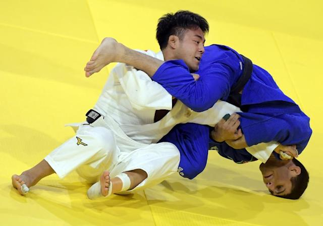 Gold medalist Japan's Soichi Hashimoto (white) competes with Azerbaian's Rustam Orujov during the final of the men's -73kg category at the World Judo Championships in Budapest on August 30, 2017 (AFP Photo/ATTILA KISBENEDEK)