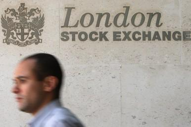 City worker passes London Stock Exchange sign