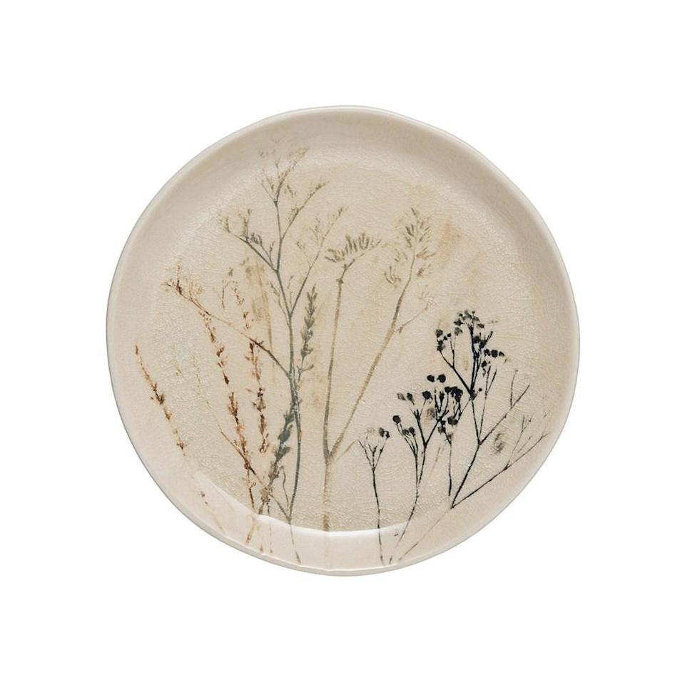 """<p>If you're looking for dinnerware pieces that you can show off, get the stunning <a href=""""https://www.popsugar.com/buy/Floral-Stoneware-Plate-582473?p_name=Floral%20Stoneware%20Plate&retailer=effortlesscomposition.com&pid=582473&price=15&evar1=casa%3Aus&evar9=47553754&evar98=https%3A%2F%2Fwww.popsugar.com%2Fhome%2Fphoto-gallery%2F47553754%2Fimage%2F47553839%2FFloral-Stoneware-Plate&list1=shopping%2Chome%20decorating%2Chome%20shopping&prop13=api&pdata=1"""" class=""""link rapid-noclick-resp"""" rel=""""nofollow noopener"""" target=""""_blank"""" data-ylk=""""slk:Floral Stoneware Plate"""">Floral Stoneware Plate</a> ($15).</p>"""