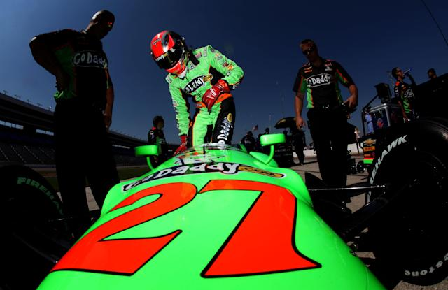 FORT WORTH, TX - JUNE 08: James Hinchcliffe of Canada, driver of the #27 Team GoDaddy.com Chevrolet Dallara, climbs into his car for qualifying for the IZOD IndyCar Series Firestone 550 at Texas Motor Speedway on June 8, 2012 in Fort Worth, Texas. (Photo by Jonathan Ferrey/Getty Images)