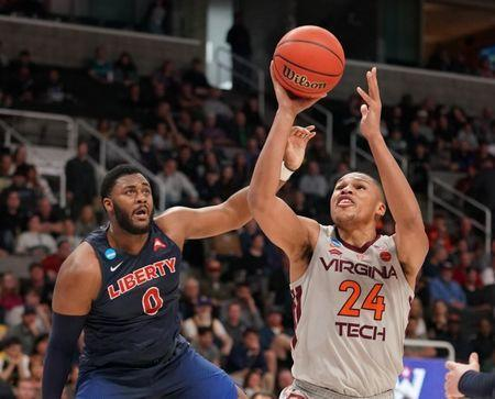 Mar 24, 2019; San Jose, CA, USA; Virginia Tech Hokies forward Kerry Blackshear Jr. (24) shoots against Liberty Flames forward Myo Baxter-Bell (0) during the first half in the second round of the 2019 NCAA Tournament at SAP Center. Mandatory Credit: Kyle Terada-USA TODAY Sports