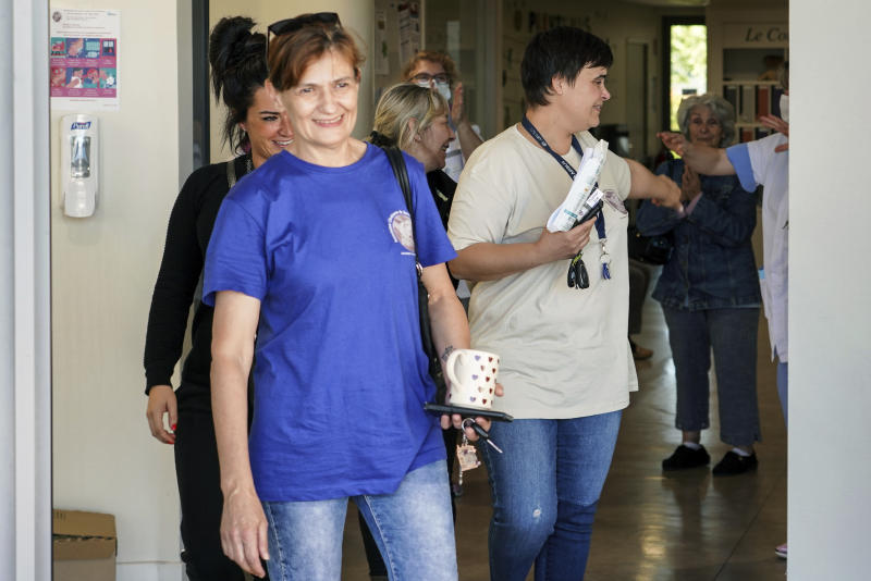 Nurses leave the Vilanova nursing home in Corbas, near Lyon, central France, Monday, May 4, 2020. For 47 days and nights, staff and the 106 residents of the Vilanova nursing home waited out the coronavirus storm together, while the illness killed tens of thousands of people in other homes across Europe, including more than 9,000 in France. Because staff and residents were locked in together, Vilanova didn't have to confine people to their rooms like other homes to shield them from the risk of infection brought in from outside. (AP Photo/Laurent Cipriani)