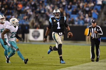 Nov 13, 2017; Charlotte, NC, USA; Carolina Panthers quarterback Cam Newton (1) runs as Miami Dolphins strong safety Nate Allen (29) defends in the third quarter at Bank of America Stadium. Bob Donnan-USA TODAY Sports