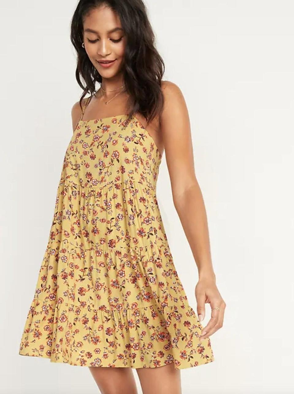 <p>We love the easy-breezy nature of this fun <span>Printed Sleeveless Tiered Swing Dress</span> ($25, originally $34). It's a great pick for warm day parties.</p>