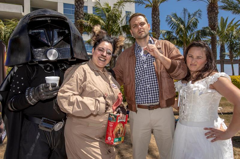 "Kenny Valdivia ""Lord Helmet"", Morena Valdivia ""Barf"" from Temecula, Calif., and Joel Bingham ""Lone Starr"" and Allison Bingham ""Princess Vespa"" from La Mesa, Calif., left-right, pose as characters from the movie ""Spaceballs."""