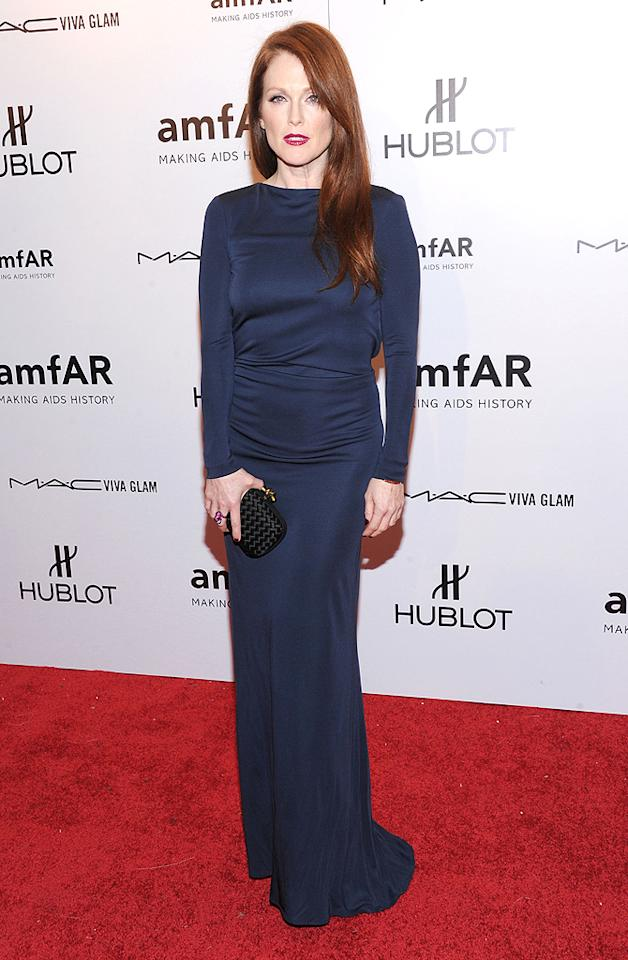As usual, famous redhead Julianne Moore, 51, looked hotter than many women half her age. She stuck with the Cavalli trend and donned a navy blue long-sleeve dress created by the designer, which she paired with a black Bottega Veneta clutch. (2/8/2012)