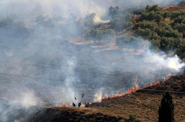 Palestinians extinguish a fire in a field around the village of Burin, south of Nablus in the occupied West Bank after Israeli settlers from the settlement of Yitzhar set it ablaze on 29 June, according to eyewitnesses from the village council (AFP via Getty Images)