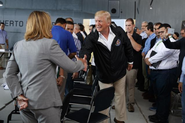 <p>President Donald Trump shakes hands with San Juan Mayor Carmen Yulin Cruz during a briefing on hurricane recovery efforts with first responders at Luis Muniz Air National Guard Base, Tuesday, Oct. 3, 2017, in San Juan, Puerto Rico. (Photo: Evan Vucci/AP) </p>