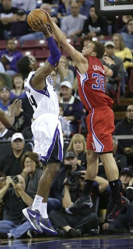 Los Angeles Clippers forward Blake Griffin, right, blocks the shot of Sacramento Kings forward Jason Thompson during the first quarter of an NBA basketball game in Sacramento, Calif., Tuesday, March 19, 2013.(AP Photo/Rich Pedroncelli)