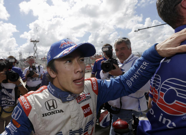 Takuma Sato, of Japan, celebrates after winning the pole position during qualifying for the IndyCar Grand Prix of Houston auto race, Saturday, Oct. 5, 2013, in Houston. (AP Photo/David J. Phillip)