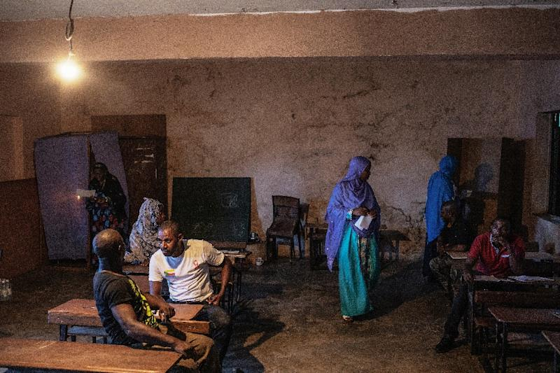 "The main Comoros opposition alleged that irregularities at several polling stations reported by the electoral commission amounted to a ""coup d'etat"" (AFP Photo/GIANLUIGI GUERCIA)"