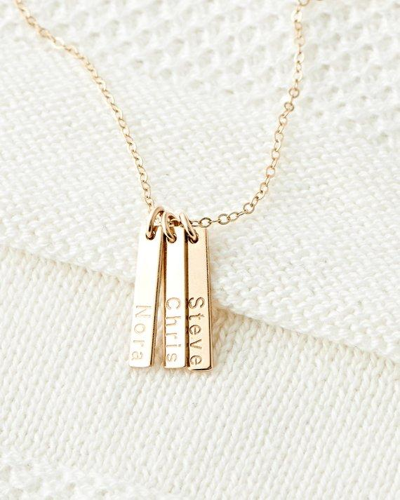 "<p><strong>BlushesAndGold</strong></p><p>etsy.com</p><p><strong>$38.00</strong></p><p><a href=""https://www.etsy.com/listing/567852961/cute-tiny-personalized-bar-necklace"" target=""_blank"">SHOP NOW</a></p><p>Customize a necklace for Mom with the names of each of her children or the dates of each birth. This way, you'll always be close to her heart. </p>"