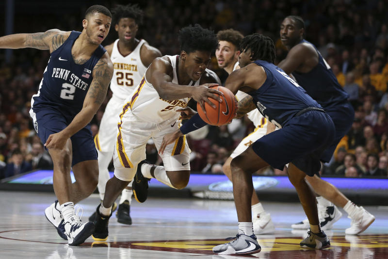 Minnesota's Marcus Carr drives the ball through the defense of Penn State's Jamari Wheeler during an NCAA basketball game Wednesday, Jan. 15, 2020, in Minneapolis. (AP Photo/Stacy Bengs)