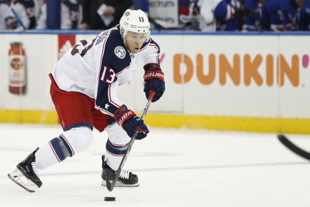 Columbus Blue Jackets right wing Cam Atkinson (13) skates with the puck during the first period of an NHL hockey game, Sunday, Jan. 19, 2020, in New York. (AP Photo/Kathy Willens)