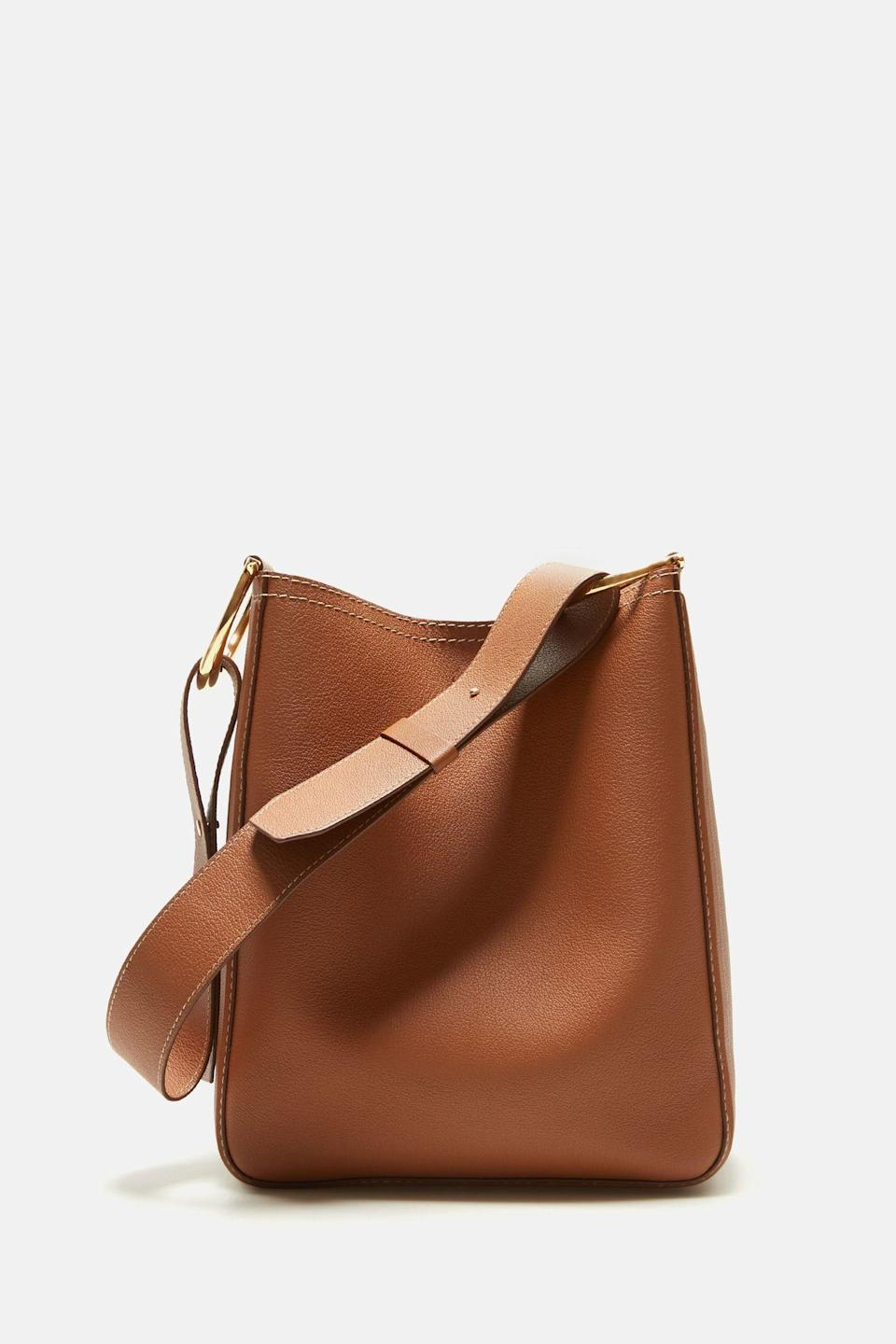 """<p><strong>CH Carolina Herrera</strong></p><p>chcarolinaherrera.com</p><p><strong>$1580.00</strong></p><p><a href=""""https://chcarolinaherrera.com/us/en/women-6756168-1/bags-6756204-1/must-haves-6756687-1/item/charro-insignia-hobo-medium-shoulder-bag-brown-aaca10dy03815-1"""" rel=""""nofollow noopener"""" target=""""_blank"""" data-ylk=""""slk:SHOP IT"""" class=""""link rapid-noclick-resp"""">SHOP IT</a></p><p>This cute mediums shoulder bag will keep all her belongings neat and tidy. As part of CH Carolina Herrera's Heart for Hope initiative with the Red Cross, the label will be donating 10 percent of all global accessories sales until December 31, 2020 to the organization.<br></p>"""