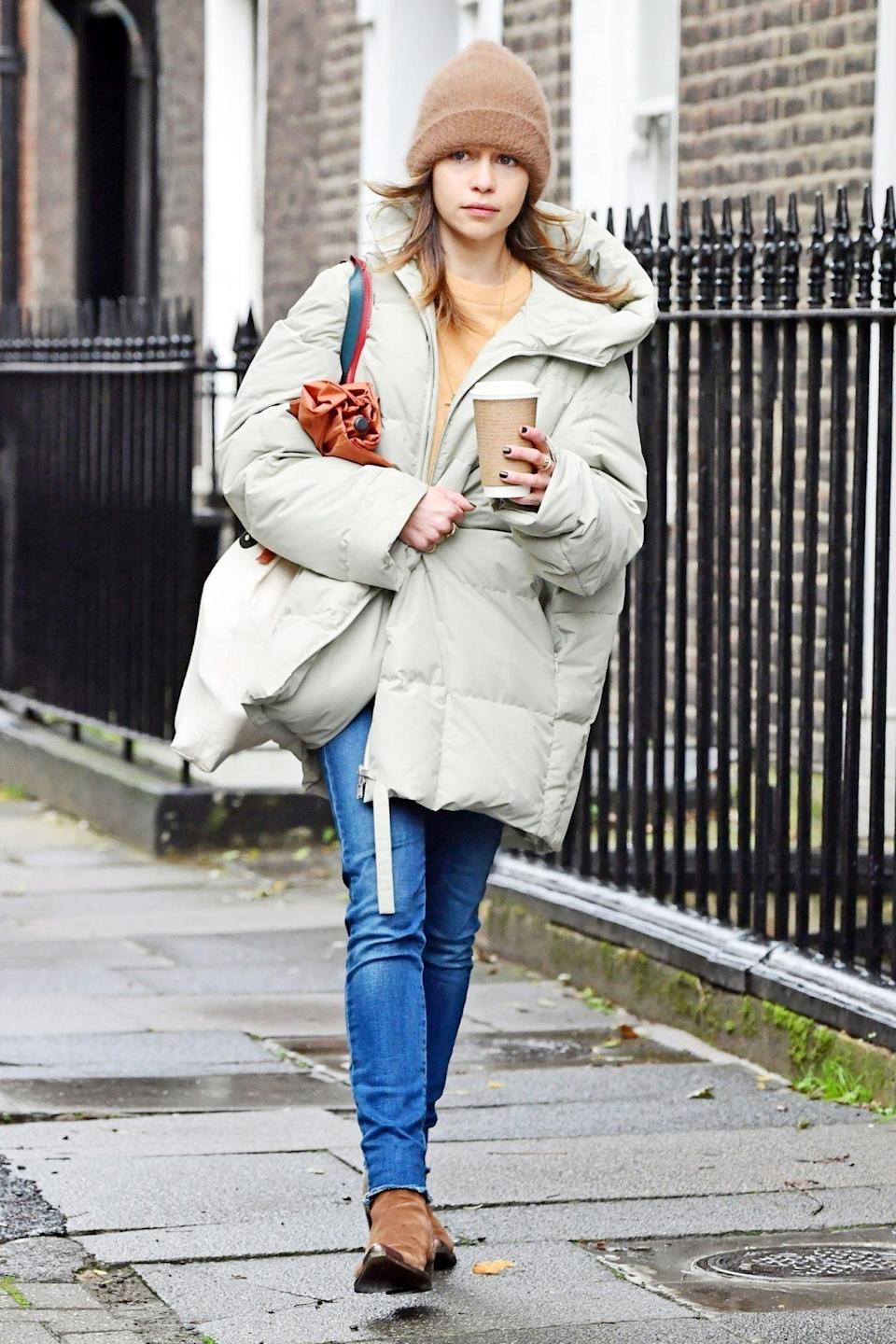 <p>Emilia Clarke keeps warm under a beanie and a chic puffer coat while out and about in London on Sunday.</p>