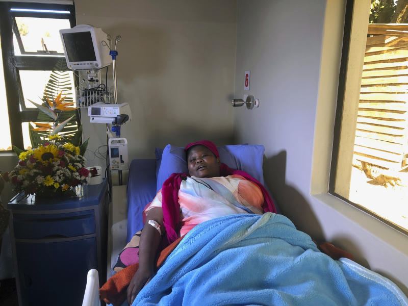 Comedian Samantha Kureya lays in her hospital bed in Harare, Thursday, Aug. 22, 2019. Kureya was abducted from her home, stripped naked and tortured by masked men with assault rifles, for performing skits perceived as being anti-government, the latest in a string of alleged abductions of government critics. (AP Photo/Tsvangirayi Mukwazhi)