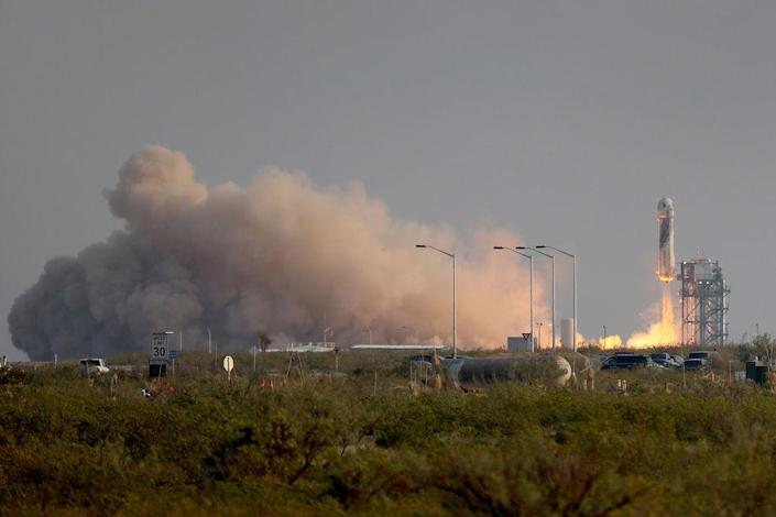 The New Shepard Blue Origin rocket lifts-off from the launch pad carrying Jeff Bezos along with his brother Mark Bezos, 18-year-old Oliver Daemen, and 82-year-old Wally Funk on July 20, 2021 in Van Horn, Texas.