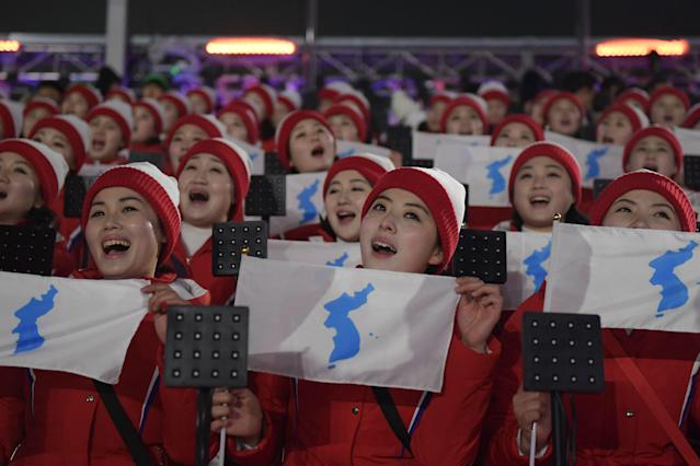"<p>North Korean cheerleaders hold ""unification flags"" as they gather ahead of the opening ceremony of the Pyeongchang 2018 Winter Olympic Games at the Pyeongchang Stadium on February 9, 2018. </p>"