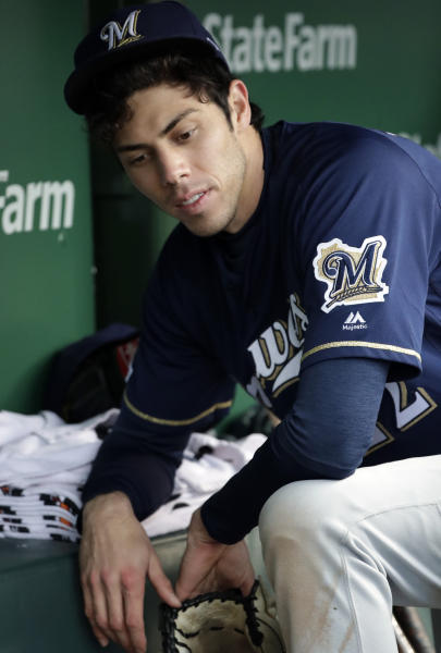 Milwaukee Brewers' Christian Yelich sits in the dugout during the 14th inning of the team's baseball game against the Chicago Cubs, Saturday, May 11, 2019, in Chicago. The Cubs won 2-1. (AP Photo/Nam Y. Huh)