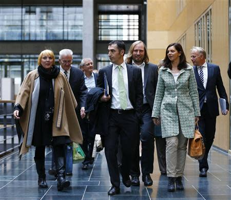 Party members of the environmental Greens party arrive for preliminary coalition talks with Germany's conservative in Berlin