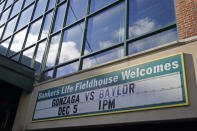 A sign outside of Bankers Life Fieldhouse shows the display for the Gonzaga vs. Baylor basketball game that was scheduled to play in an NCAA college basketball game, Saturday, Dec. 5, 2020, in Indianapolis. The game was canceled due to COVID. (AP Photo/Darron Cummings)