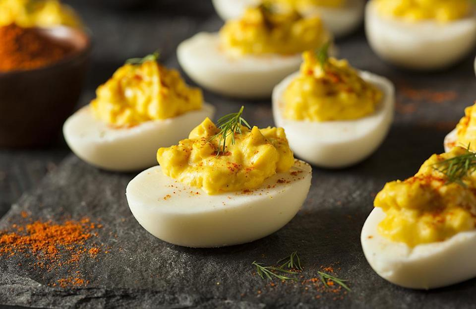 """<p>Deviled eggs are one of those<a href=""""https://www.thedailymeal.com/cook/best-retro-recipes-gallery?referrer=yahoo&category=beauty_food&include_utm=1&utm_medium=referral&utm_source=yahoo&utm_campaign=feed"""" rel=""""nofollow noopener"""" target=""""_blank"""" data-ylk=""""slk:retro appetizers that have stood the test of time"""" class=""""link rapid-noclick-resp""""> retro appetizers that have stood the test of time</a>, and they're a great hors d'oeuvre to make or bring to most parties. But the egg yolk-and-mayonnaise-based filling inside a perfectly hard-boiled egg can spoil quickly, so save all of those <a href=""""https://www.thedailymeal.com/cook/eggs-101?referrer=yahoo&category=beauty_food&include_utm=1&utm_medium=referral&utm_source=yahoo&utm_campaign=feed"""" rel=""""nofollow noopener"""" target=""""_blank"""" data-ylk=""""slk:amazing egg recipes"""" class=""""link rapid-noclick-resp"""">amazing egg recipes</a> for an indoor occasion.</p>"""