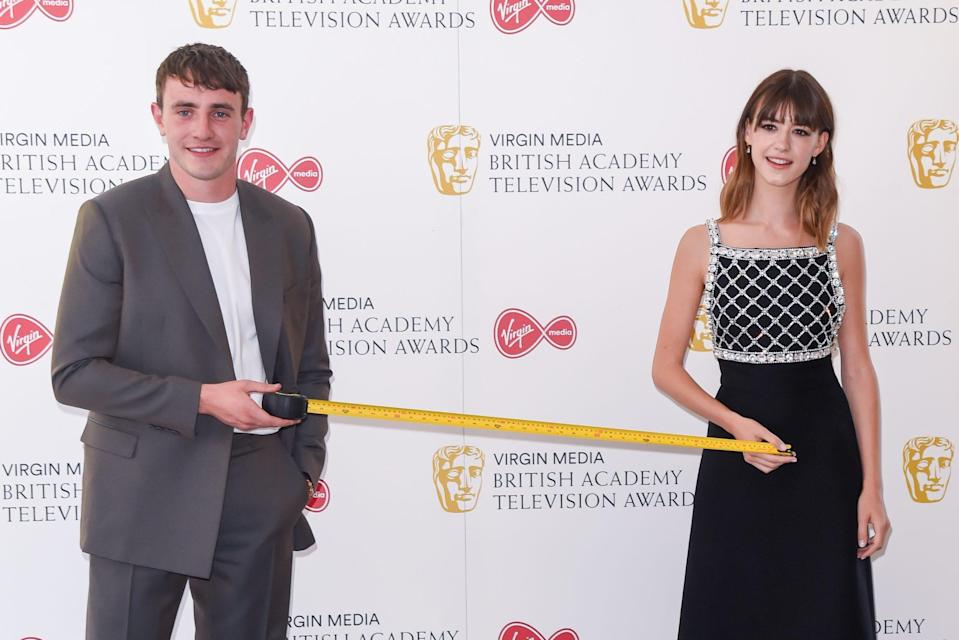 <p><em>Normal People</em>'s Paul Mescal and Daisy Edgar-Jones demonstrate proper social distancing on Friday at the Virgin Media British Academy Television Award 2020 at Television Centre in London. </p>