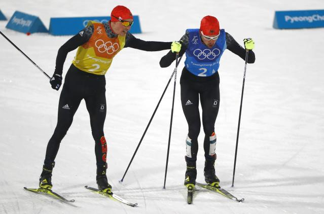 Nordic Combined Events - Pyeongchang 2018 Winter Olympics - Men's Team 4 x 5 km Final - Alpensia Cross-Country Skiing Centre - Pyeongchang, South Korea - February 22, 2018 - Eric Frenzel of Germany and Johannes Rydzek of Germany exchange. REUTERS/Dominic Ebenbichler