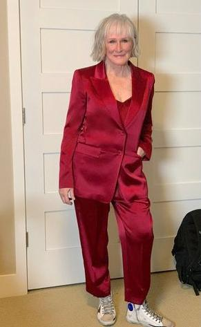 """<p>The actress' red satin Lafayette 148 suit is something that's """"fully integrated"""" into her everyday wardrobe, the actress's stylist <a href=""""https://www.instagram.com/chloehartstein/"""" rel=""""nofollow noopener"""" target=""""_blank"""" data-ylk=""""slk:Chloe Hartstein"""" class=""""link rapid-noclick-resp"""">Chloe Hartstein</a> tells PEOPLE. """"With Glenn currently living in Montana, we wanted to keep the logistics down to a minimum, but also be mindful of what is currently happening in the country and the world.""""</p> <p>So they got inspired. """"Recycling an outfit from Glenn's incredible archive felt like a timely idea, following in the footsteps of what <a href=""""https://people.com/style/cate-blanchett-red-carpet-style-venice-film-festival-2020/"""" rel=""""nofollow noopener"""" target=""""_blank"""" data-ylk=""""slk:Cate Blanchett and [stylist] Elizabeth Stewart did at the Venice Film Festival"""" class=""""link rapid-noclick-resp"""">Cate Blanchett and [stylist] Elizabeth Stewart did at the Venice Film Festival</a>,"""" Hartstein, who paired the chic satin suit with Golden Goose sneakers and Cartier jewels, explains.</p>"""