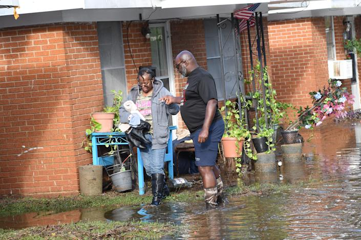 Stephen Chark, right, helps Carrie Smith as she leaves her home on 14th Street off Willow Glen Road in Alexandria, Louisiana. Saturday, Oct. 10, 2020. Hurricane Delta dumped heavy rains in the area flooding most streets and houses off Willow Glen.